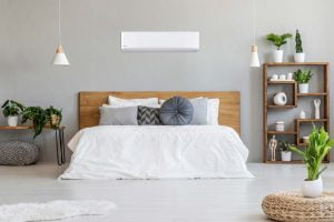 A modern bedroom with a heat pump